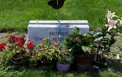Brother's grave with flowers